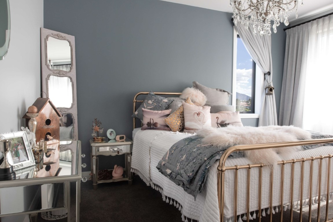 bedroom-interior-design-rose-gold-bed-grey-wall-pink-cushions-bedspread-mirror-side-table-arcline-architecture