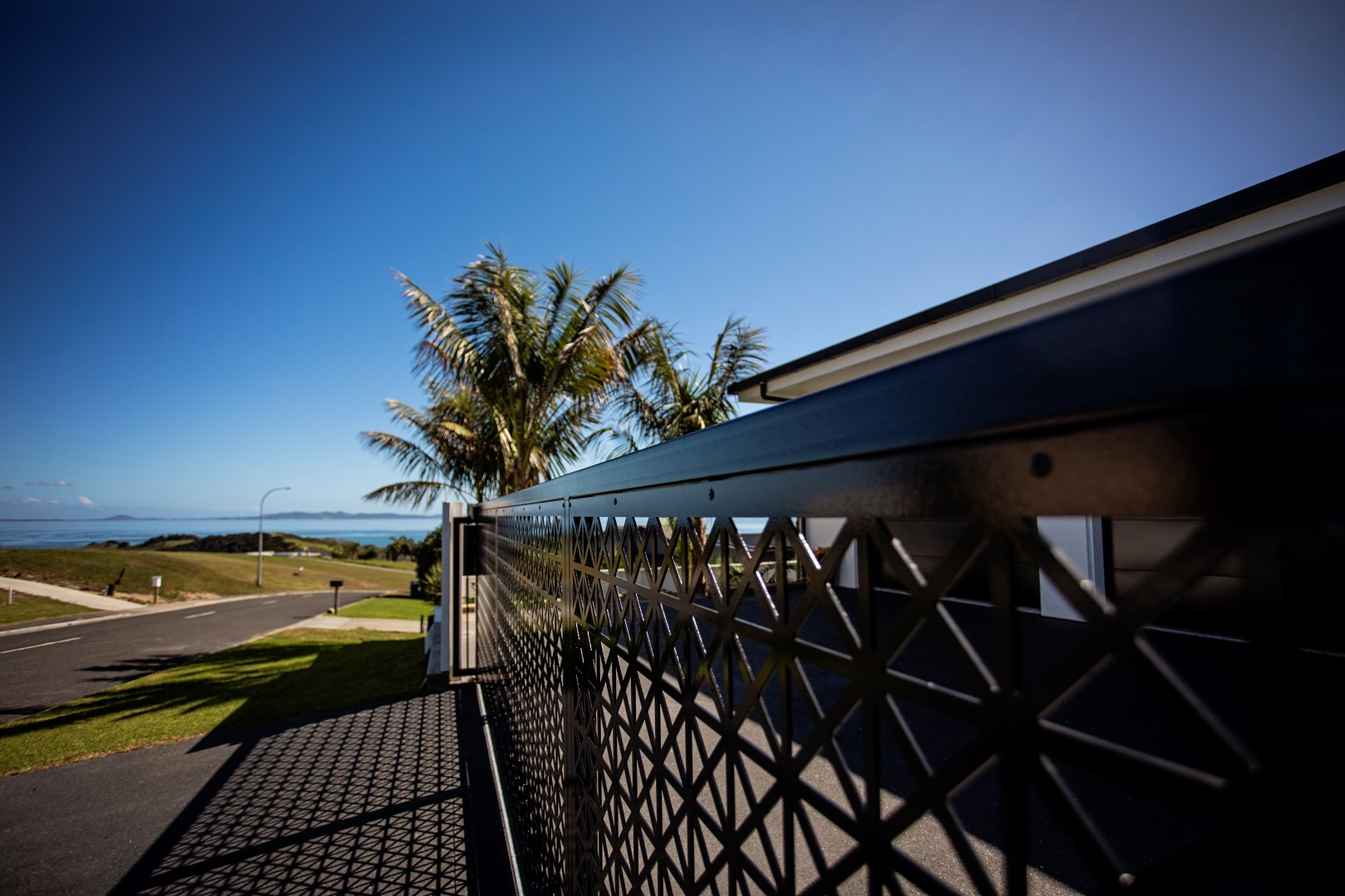front-gate-entry-water-jet-cut-driveway-arcline-architecture